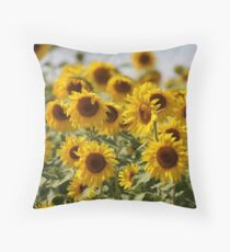 Sunflowers swaying in the wind close to Throw Pillow