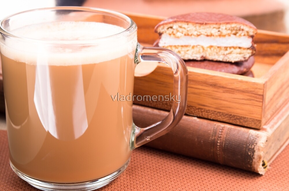 Glass mug with hot chocolate and biscuits in a wooden tray by vladromensky