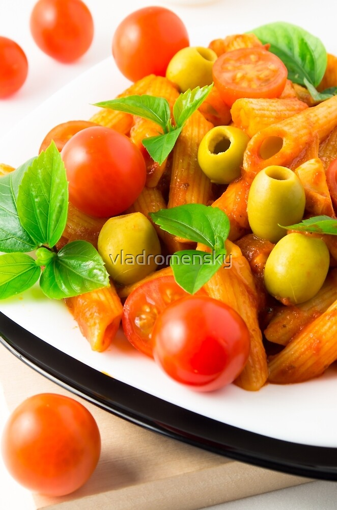 Detail of a plate closeup Italian pasta penne with tomato sauce by vladromensky