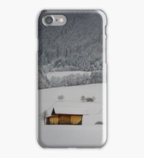 Barn on a snow covered German hillside iPhone Case/Skin