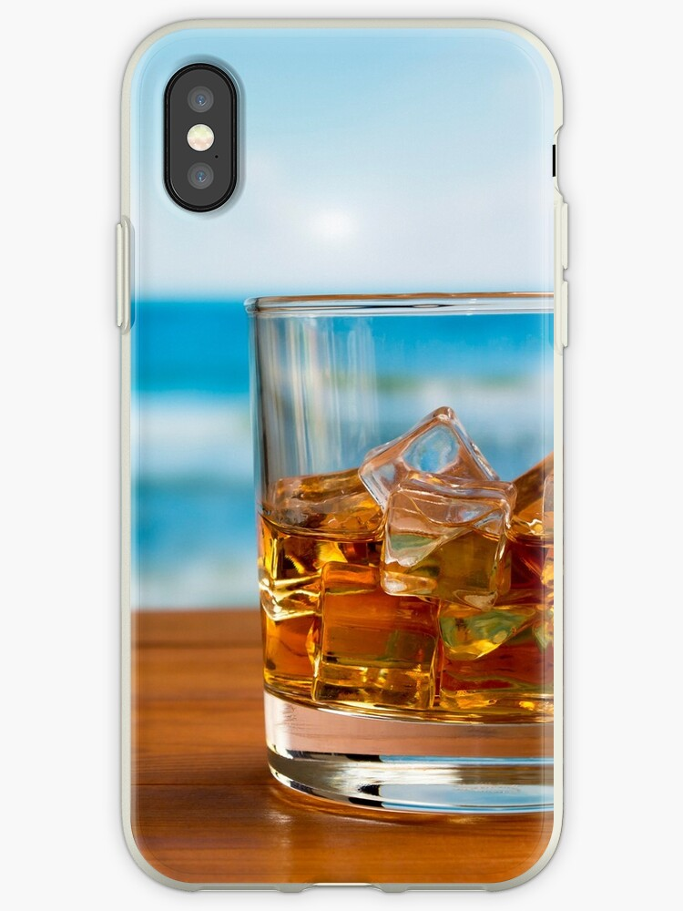 Glass of Whisky With Ice on a Wooden Table Against The Sea by MarkUK97