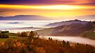 Blurred sunset over a sea of fog by Delfino