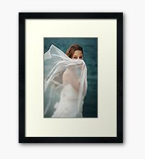 Beautiful Woman in White Dress Standing against Stormy Sea Framed Print