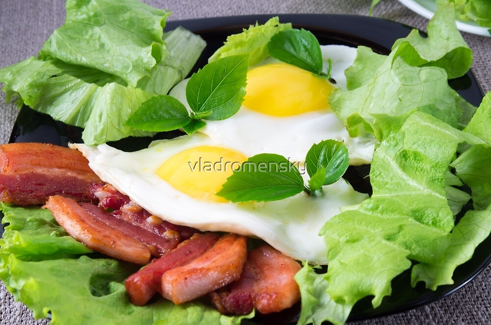 Fried eggs with herbs, lettuce and  bacon by vladromensky
