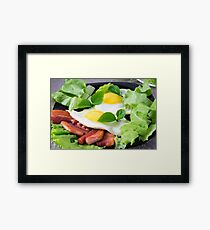Fried eggs with herbs, lettuce and  bacon Framed Print