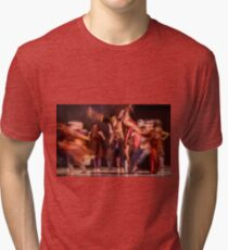 Group of contemporary dancers performing on stage Tri-blend T-Shirt