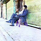 Two old men sitting in the street by Giuseppe Cocco