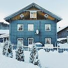 White Christmas - Typical Norwegian Farmhouse With Illuminated Xmas Decoration in Window by visualspectrum