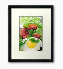 Plate with egg yolk, fried bacon and herbs Framed Print