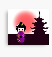 Japanese kokeshi doll at temple during sunset Canvas Print