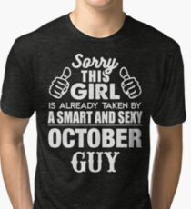 SORRY THIS GIRL IS ALREADY TAKEN BY A SMART AND SEXY OCTOBER GUY Tri-blend T-Shirt
