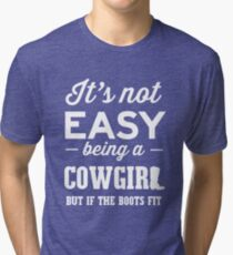 It's not easy being a cowgirl but if the boot fits Tri-blend T-Shirt