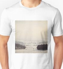 Snow covers the land T-Shirt