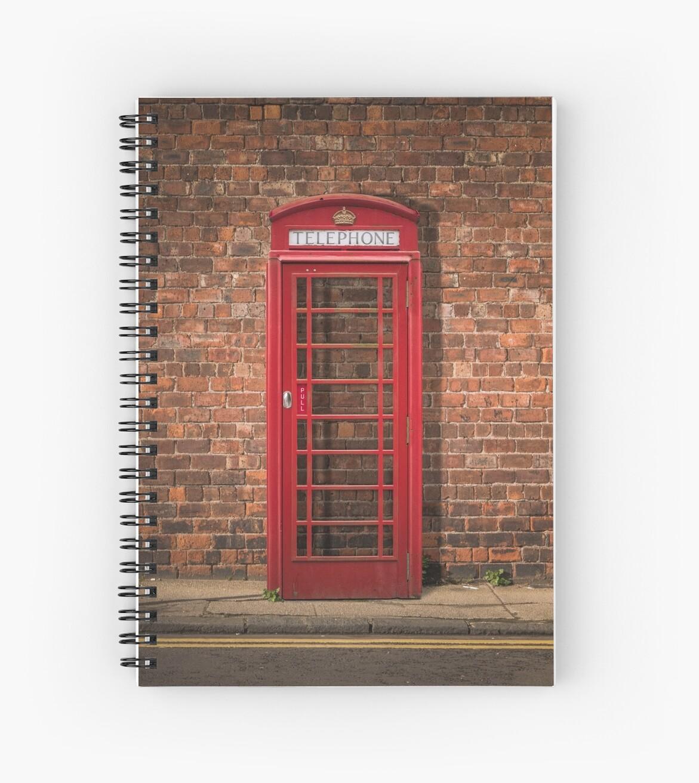 British Phone Box Against Red Brick Wall by mrdoomits