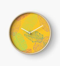 Banana leafes on yellow retro background Clock