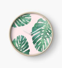 Watercolor tropical monstera leaves on pink background Clock