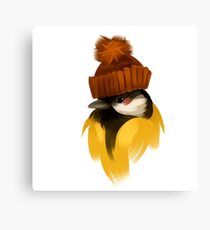 Cute bird in a winter knitted hat Canvas Print