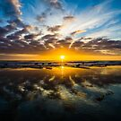 Reflections in the Sand: Sunset at Sands Beach by Brian Haidet