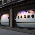 Airplane in a Store Window, 5th Avenue, New York City by lenspiro