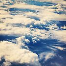 Clouds, from an airplane by Derek Michael Brennan