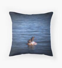 Boppin Along a baby sea lion basks on a buoy Seal Pup Throw Pillow