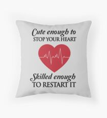 Nurses: Cute enough to stop your heart. Skilled enough to restart it Throw Pillow