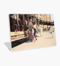 Mother helps her child off trolley in NYC — Colorized Laptop Skin