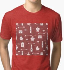Cute seamless pattern with various accessories for the care of your body and hair: perfume bottles in the shape of a heart, cream, hair spray and other. Tri-blend T-Shirt