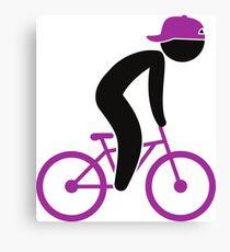 A cyclist doing tricks on his bike Canvas Print