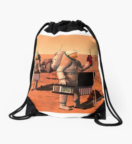 Das Konzept des Künstlers von den Astronauten, die Wetterüberwachungsausrüstung auf Mars errichten. Turnbeutel