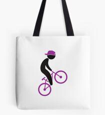 A cyclist doing tricks on his bike Tote Bag