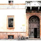 Door balcony and bicycle by Giuseppe Cocco