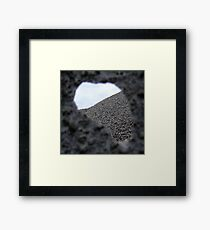 Hole in fence Framed Print