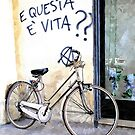 Bicycle with writing on the wall by Giuseppe Cocco