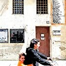 Mother and son cycling by Giuseppe Cocco
