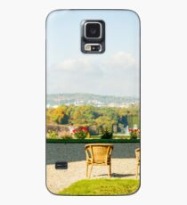 A couple of chairs on the top of a lookout watching the landscape I Case/Skin for Samsung Galaxy