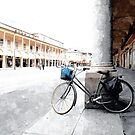 Bicycle leaning against a column by Giuseppe Cocco