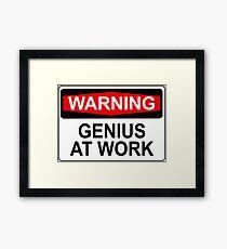 WARNING: GENIUS AT WORK Framed Print