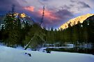 Sunset at the green lake in winter by Delfino