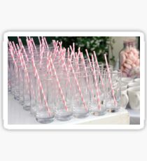 A buffet of pink drinking straws in glasses  Sticker
