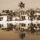 View of the cottages and lagoon water in Alleppey, Kerala, India by ashishagarwal74