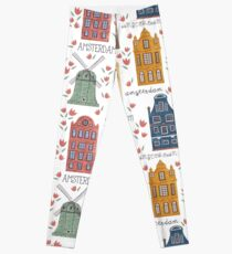 Amsterdam. Seamless pattern with old historic buildings and traditional architecture of Netherlands. Windmill and houses with tulip flowers.  Leggings