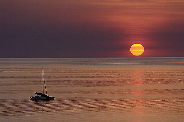 Sunset and yacht by graynomad