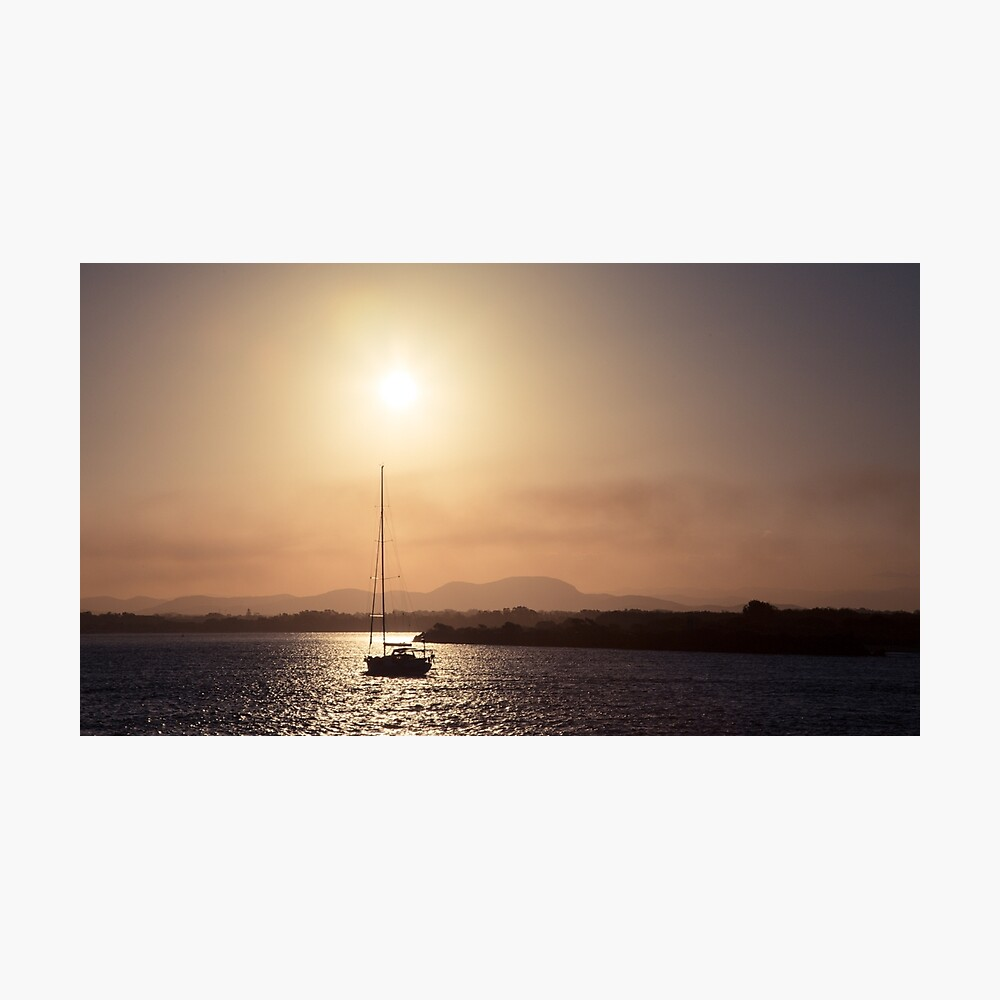 Sailing boat at sunset Photographic Print