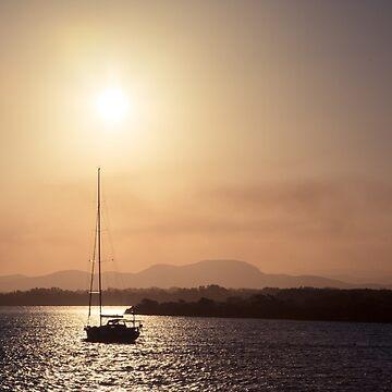 Sailing boat at sunset by halans