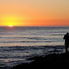 Photographer at sunrise by kirsty