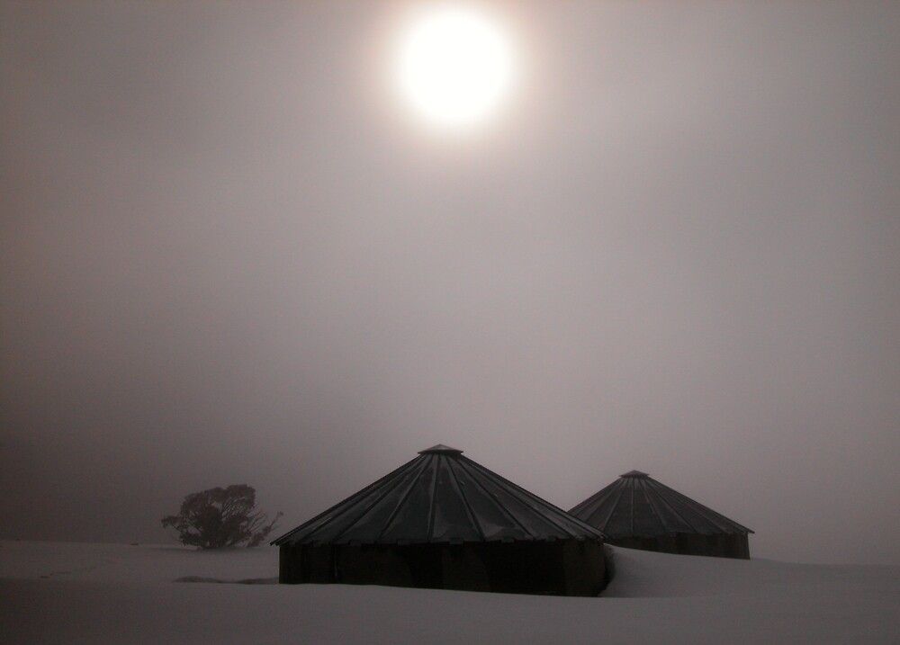 Shrouded Sun over Snowbound Water Tanks by John Barratt
