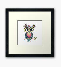 Cute colorful cartoon owl sitting on tree branch Framed Print