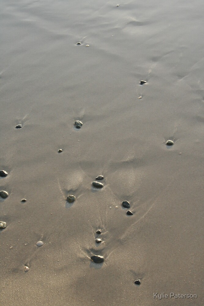 Pebbles in the sand by Kylie Paterson