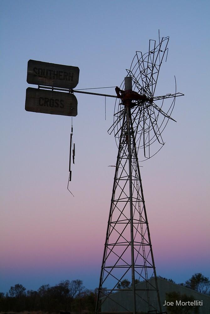 Windmill, Mt Dare Station,Outback Australia by Joe Mortelliti